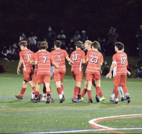 The boys soccer team celebrates after scoring against Bishop Eustace in a 5-2 win on senior night.