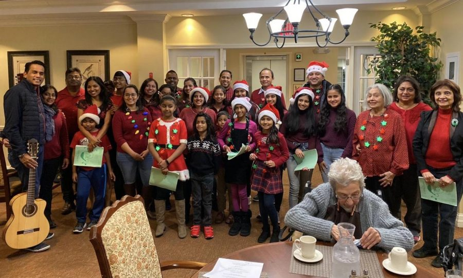 Last year, Nicole Vital ('22) and about seven other families sang carols at the Atria senior living center in Cherry Hill.
