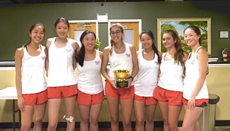 The girls tennis team is very proud of the season they had.