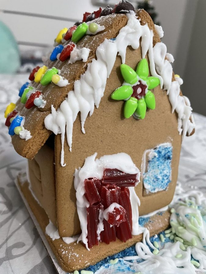 Abby Yu ('23) decorates a gingerbread house for the holidays.