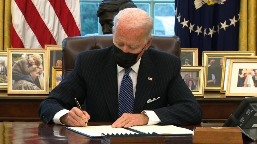 Biden signs the executive order, reversing Trump's ban on transgenders entering the military.