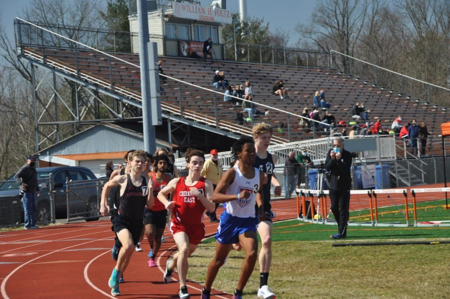 Peter Tepper ('23) is near the front of the pack on lap two of his Boys' 800 meter finish.