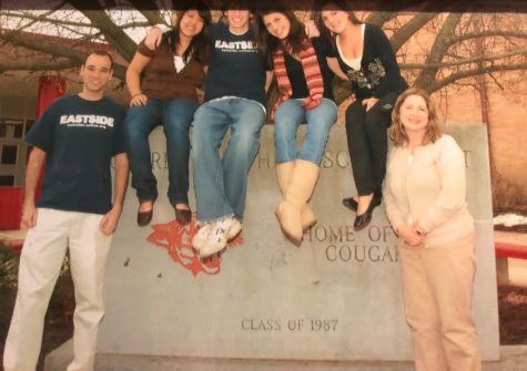 The advisers and officers of the senior Class of 2008 pose for a picture with the symbolic stone.