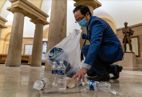 Rep. Kim cleans up debris and trash on the floor of the Capitol after the Capitol Insurrection, an act that brought him national attention.