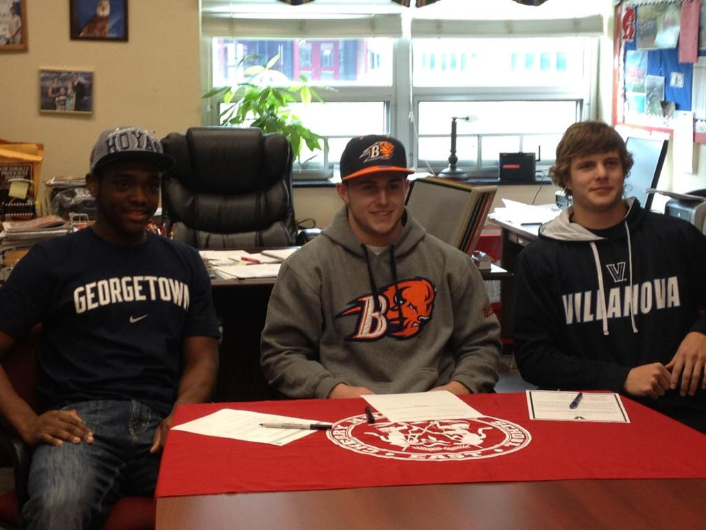 From+left+to+right%3A+Satchell%2C+Regan+and+Reber+pose+before+signing+their+letters.