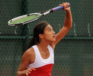 Rachel Pham (16) serving a ball.