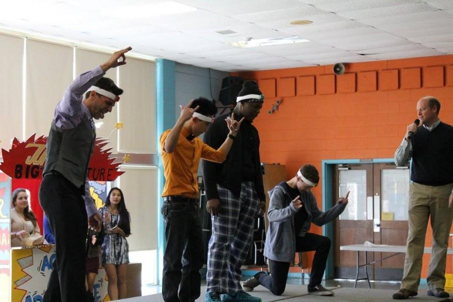Students rock their heads to the beat of the music.