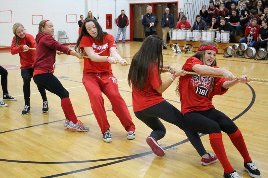Students try to win tug of war with determination.