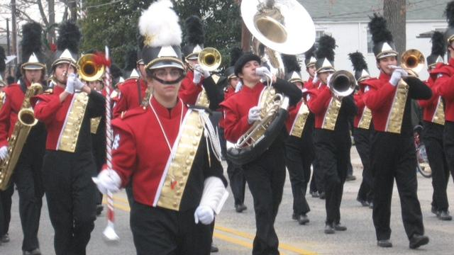 Marching Band with one of its drum majors, Lauren Feldman (15) at left in the front.