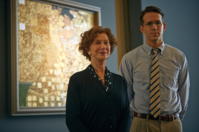 """From left to right, Helen Mirren as Maria Altmann, and Ryan Reynolds as Randy Schoenberg stand in front of the famous """"Woman in Gold"""" painting that they fight to reclaim."""