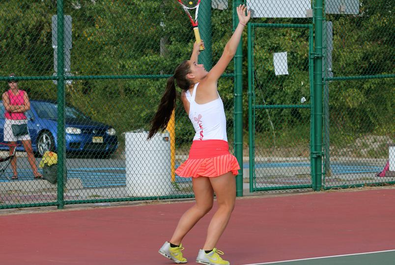 Steph Yanosov ('17) makes a powerful serve to her opponent.