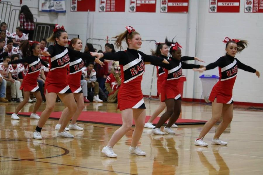 East+cheerleaders+help+to+prepare+the+cougars+for+the+East+vs+West+football+game