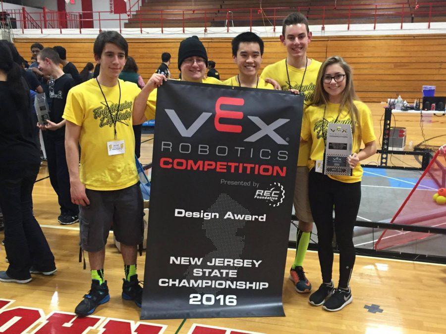 Jason Fisch (16) and Nikola Kursaic  (16) pose alongside fellow team members.