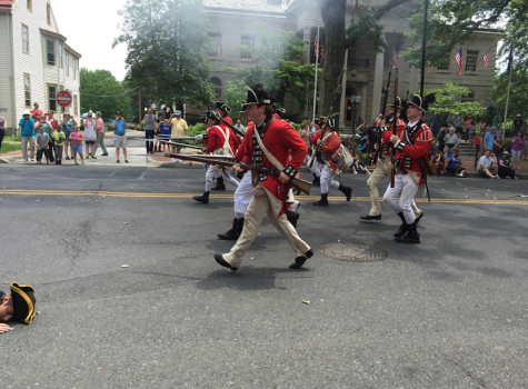 Soldiers fire their muskets at the Revolutionary War reenactment hosted by the Indian King Tavern.