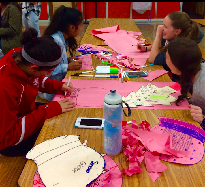 Students make table decorations of various designs for the holiday party.