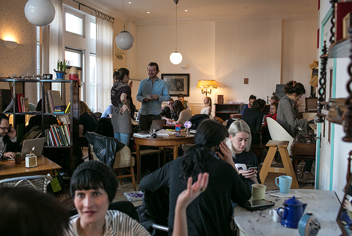 Guests mingle at a Ziferblat cafe.