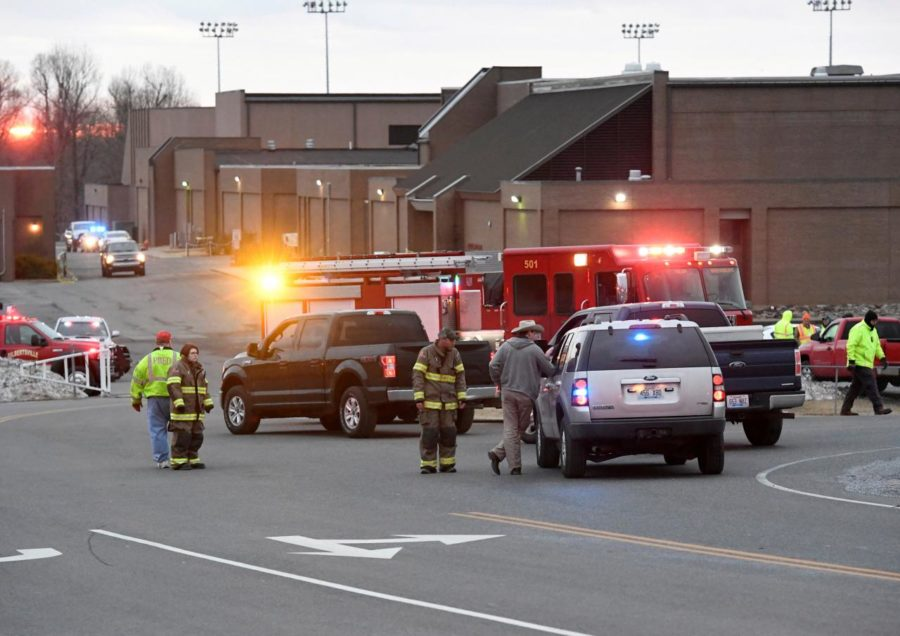 Police investigators are seen at the scene of a shooting at Marshall County High School in Benton, Kentucky, U.S.