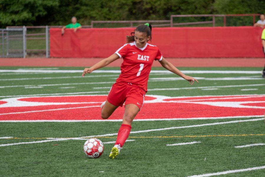 Bella Rossetti ('20) dominantly kicks the ball in their game against Eastern High School on September 15, 2018.