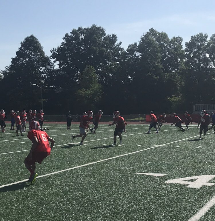 Members of the East football team run plays during a summer practice. Photo courtesy of Coach Andrew Daley.