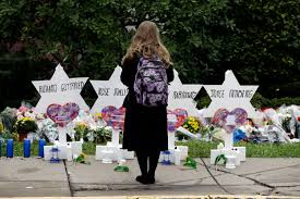 A woman pays her respects to the victims of Saturday's Tree of Life Synagogue shooting in Pittsburgh, PA.
