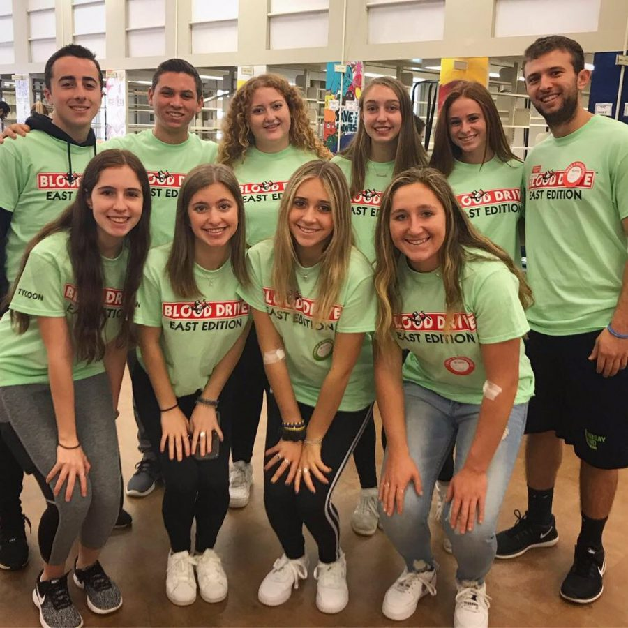 Blood Drive student organizers wear their Monopoly themed shirts.