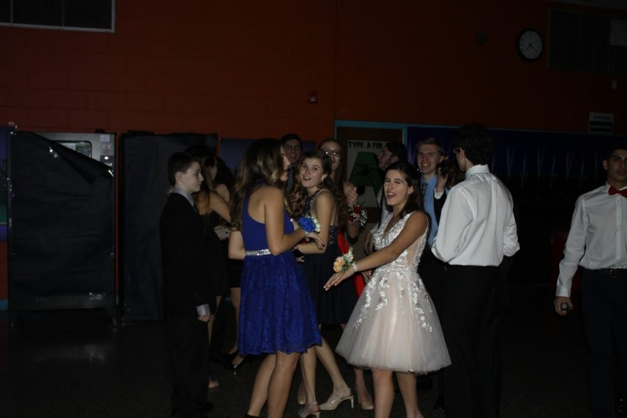 Students enjoy each other's company on the dance floor.