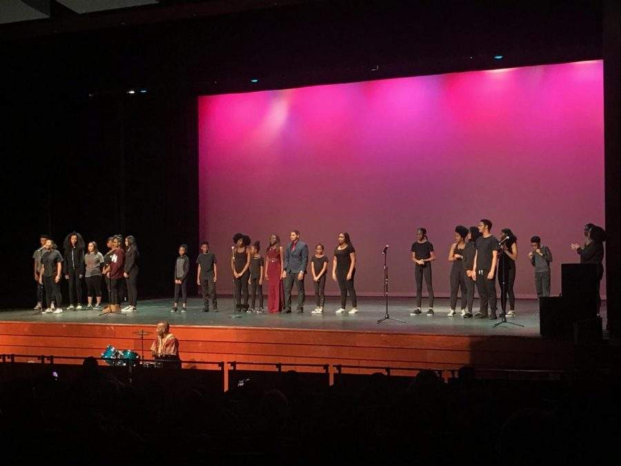 Club+members+perform+together+onstage.