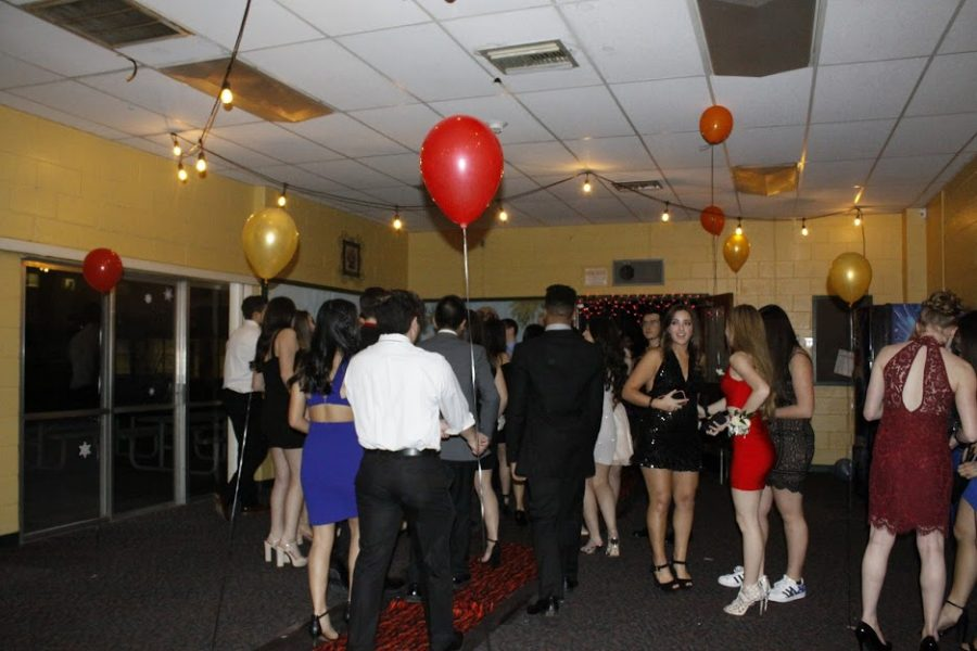 Students prepare to enter the dance floor.