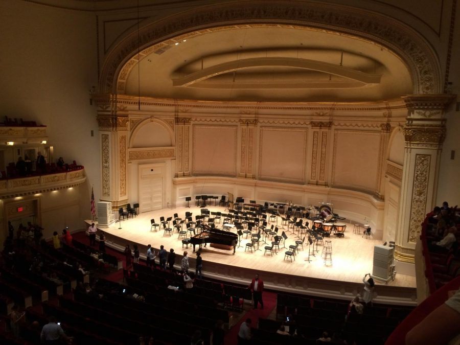 An overview of the Carnegie Hall stage where the symphony orchestra performed.
