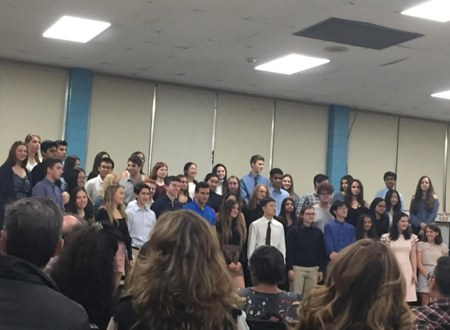 New members of the Cherry Hill East chapter of the National English Honors Society await their certificates during inductions
