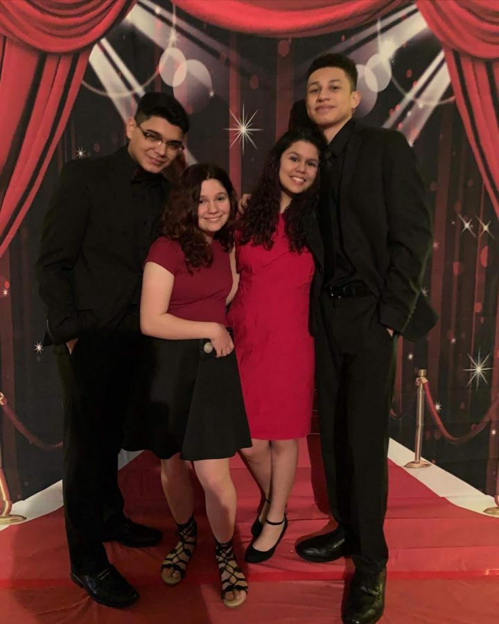 East students pose for a picture at the red carpet.