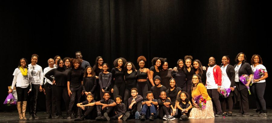 The cast and crew of the production come together after the final performance to pose for the camera.