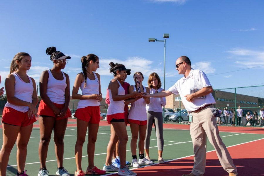 Girls Tennis receives the sectional trophy after their win over Egg Harbor.