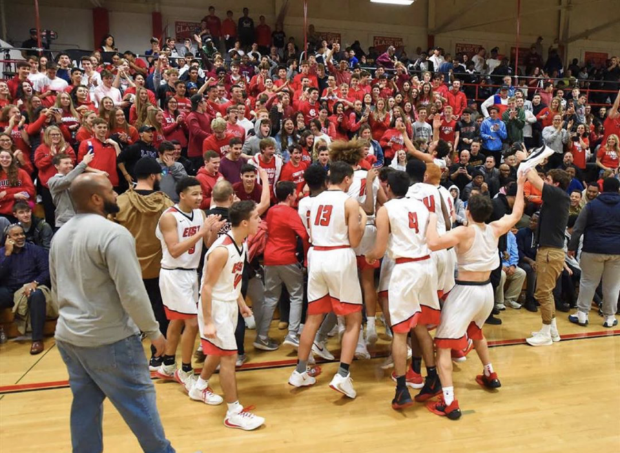 The+boys+basketball+team+and+the+fan+section+go+crazy+after+a+thrilling+game.++