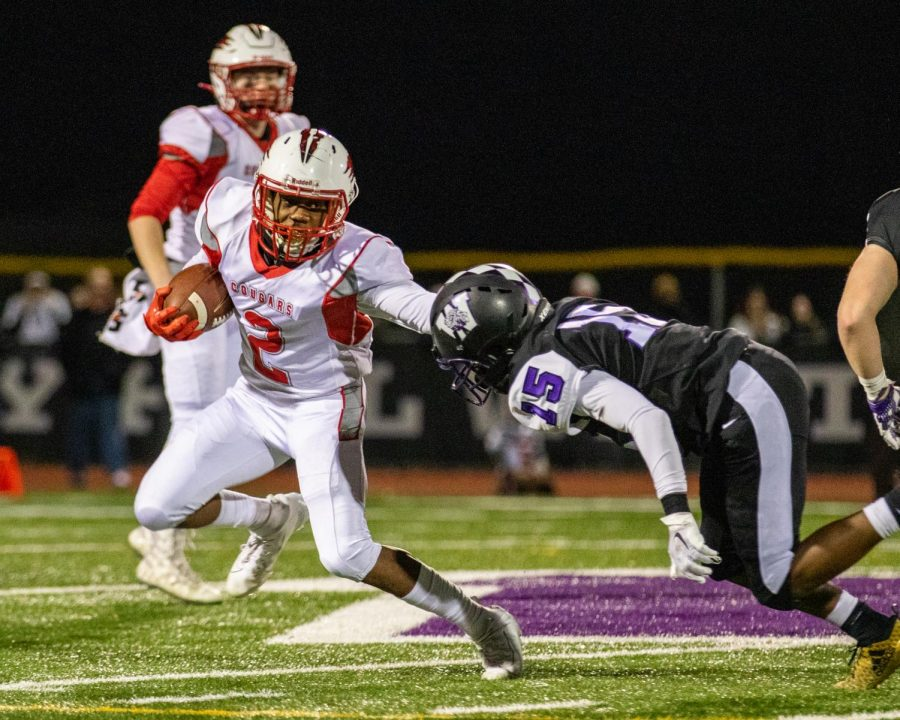 Khalil Harden ('22) stiff arms a Cherry Hill West player during the homecoming football at Cherry Hill West on November 27, 2019.