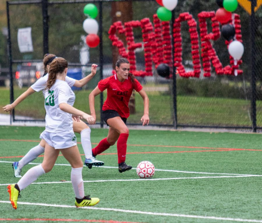 Bella Rosetti ('20) fights to the goal as she dribbles through the rain.