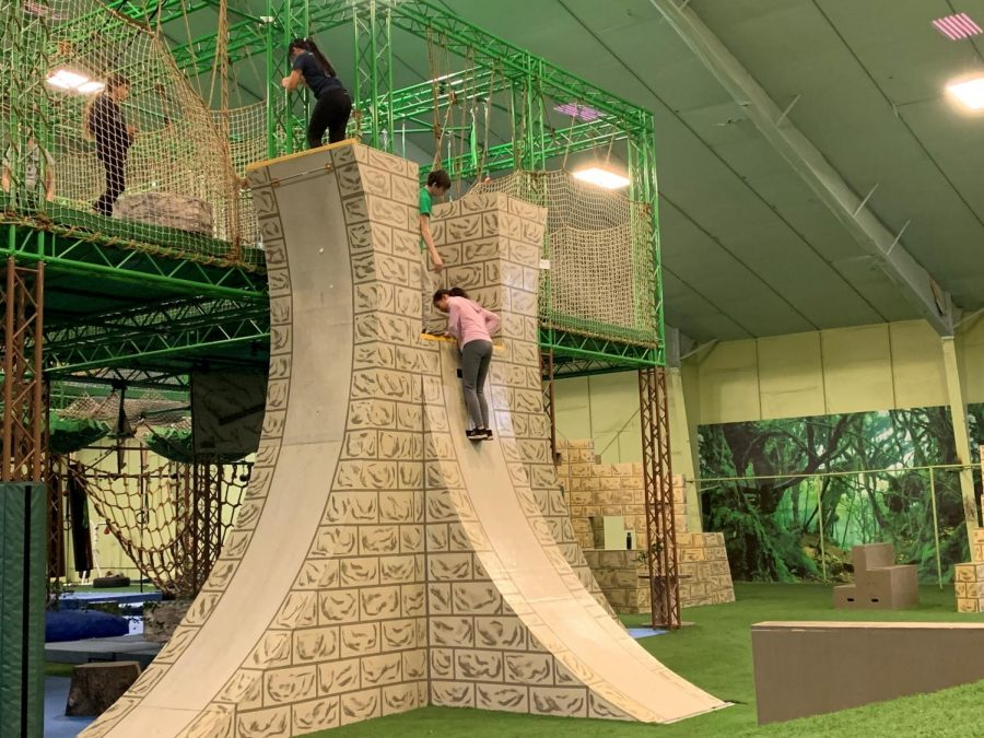 Gym+members+attempt+to+climb+the+famed+%22warped+wall%22