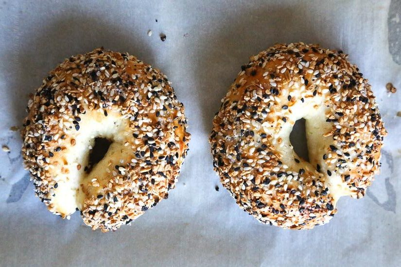 Delicious bagels topped with poppy seeds and sesame seeds.