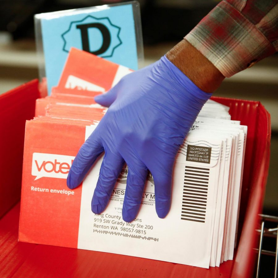 Election official sorts mail-in ballots