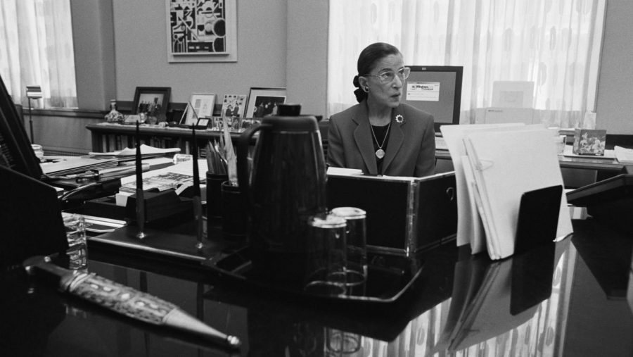 Ginsburg+sits+in+her+chambers+in+Washington+D.C.+as+she+files+through+her+work.+