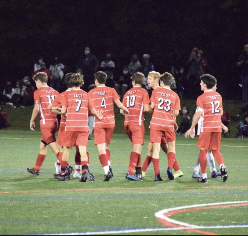 The+boys+soccer+team+celebrates+after+scoring+against+Bishop+Eustace+in+a+5-2+win+on+senior+night.