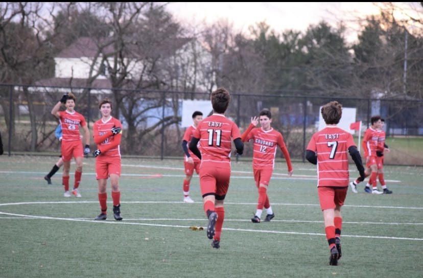 The East Cougars dominate Vineland in an intense soccer game.