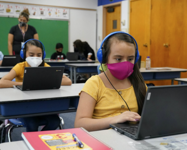 Students return to in-person learning but maintain safety precautions in Denver, Colorado.
