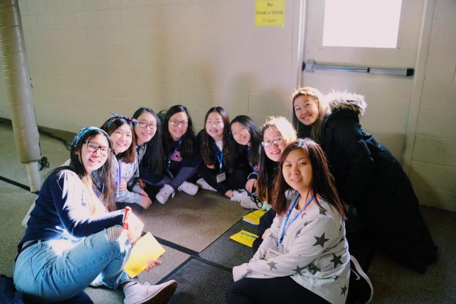 Yena sits in middle of a small group session at a church retreat with her friends.