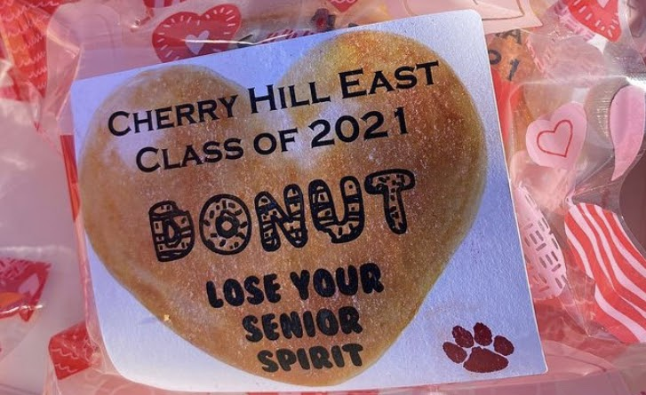 The packaged donuts have a motivating message on the front for the seniors.