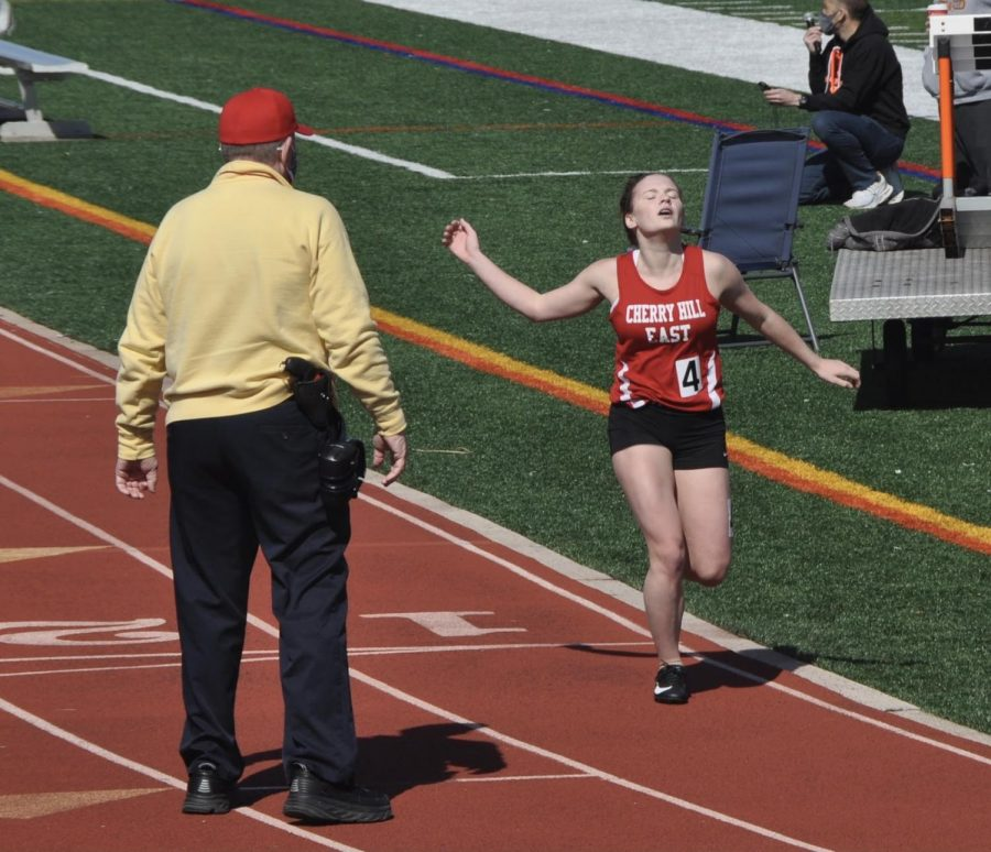 Maddie McNiff ('22) crosses the finish line as winner of Heat 1 in the Girls' 3200 meter run.