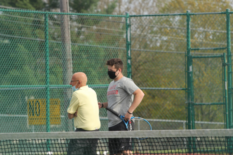Senior Jacob Pasternack speaks with the referee after his doubles victory with Matt Dickinson ('21)  against Cherokee.