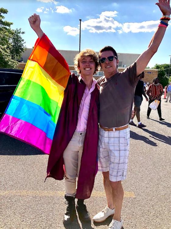 Eastern Regional High School graduate Bryce Dershem and his father, Michael Dershem, celebrate at Bryce's graduation ceremony.