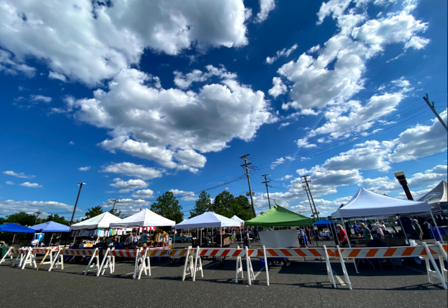 Many tents are set up at the Marlton Greene Shopping Center with various local goods for sale.