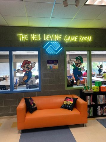 All of the photos taken in this were taken by Max Gaffin in the actual game room with Neil Levines family members welcoming our community into this new special place.